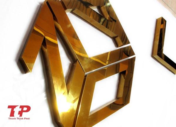 logo chữ nổi inox vàng